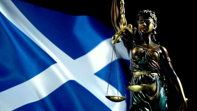 justice statue with scottish flag - courthouse stock videos & royalty-free footage