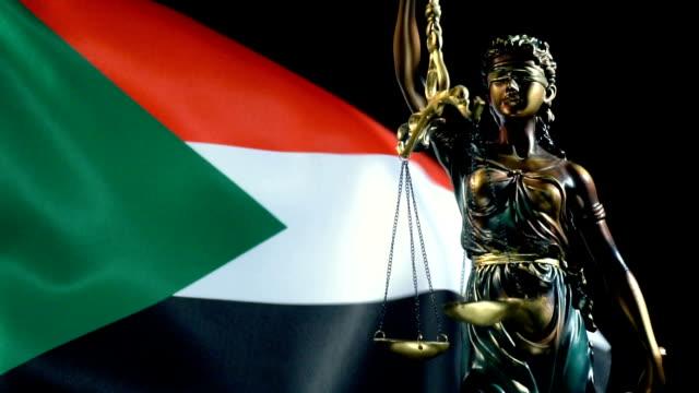 rättvise statyn med sudanesiska flaggan - durra bildbanksvideor och videomaterial från bakom kulisserna