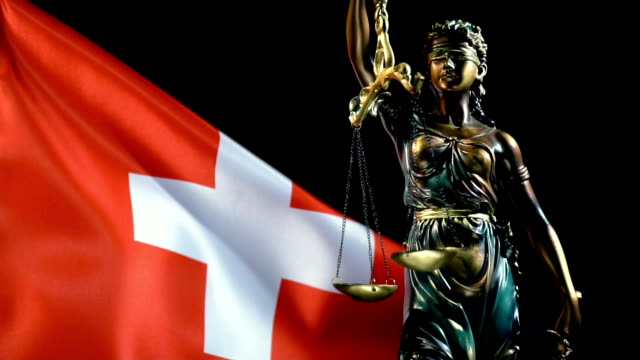 justice statue with swiss flag - switzerland stock videos & royalty-free footage