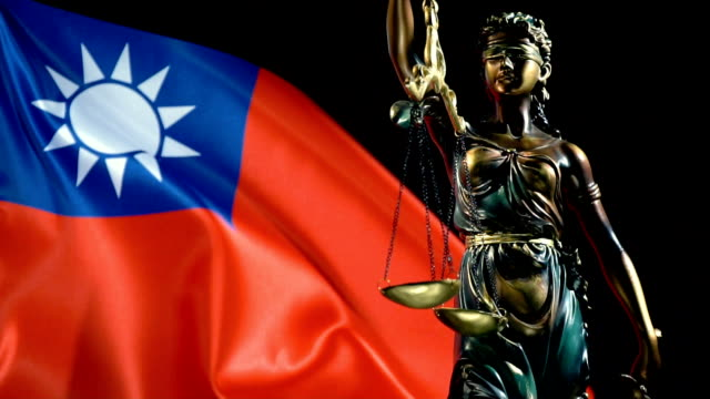 justice statue with taiwanese flag - taiwanese flag stock videos & royalty-free footage