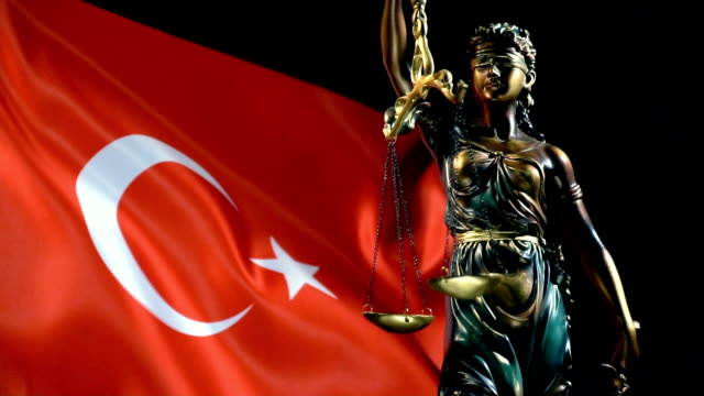 justice statue with turkish flag - lawyer stock videos & royalty-free footage