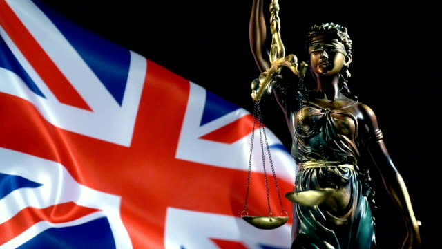 justice statue with united kingdom flag - prisoner uk stock videos & royalty-free footage