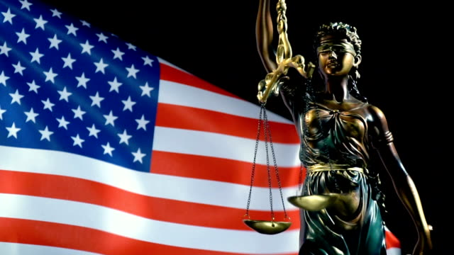 justice statue with united states flag - juror law stock videos & royalty-free footage