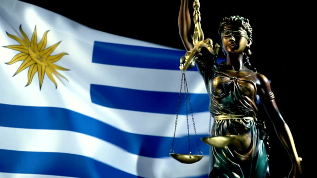 justice statue with uruguaian flag - uruguaian flag stock videos & royalty-free footage