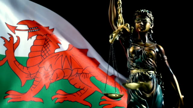 justice statue with welsh flag - prince of wales stock videos & royalty-free footage