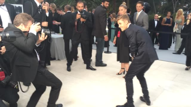 justin bieber at amfar red carpet at hotel du capedenroc on may 22 2014 in cap d'antibes france - 2014 stock videos and b-roll footage