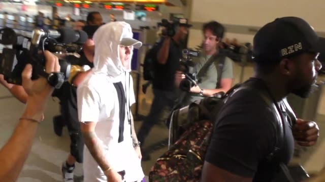Justin Bieber gets mobbed by paparazzi as he departs at LAX Airport in Los Angeles in Celebrity Sightings in Los Angeles