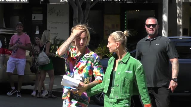 justin bieber hailey baldwin greet fans at sugerfish then walk to montage hotel in beverly hills in celebrity sightings in los angeles - justin bieber stock videos & royalty-free footage
