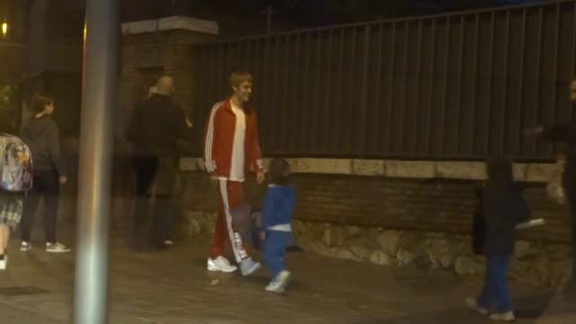 Justin Bieber is seen walking through the streets of Barcelona and playing with kids