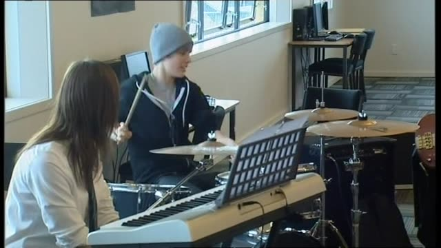 justin bieber playing enthusiastic solo on drum kit during visit to strathallan college music class in 2010 - solo performance stock videos and b-roll footage