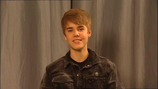 Justin Bieber speaking about friend Selena Gomez during satellite interview with presenter Mark Sainsbury in 2011