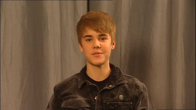 justin bieber speaking about retaining privacy in his life during satellite interview with presenter mark sainsbury in 2011 - ドキュメンタリー映画点の映像素材/bロール