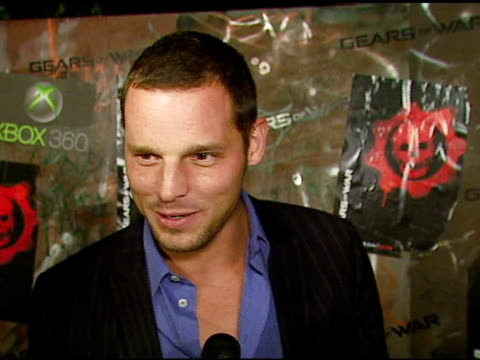 justin chambers on wanting to try out the new game, the atmosphere of the party at the cemetary, plans for halloween at the xbox 360 'gears of war'... - ギアーズオブウォー点の映像素材/bロール