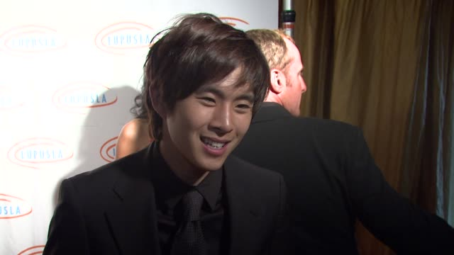 justin chon on the event young hollywood's support of charity 'new moon' at the 9th annual lupus la orange ball at beverly hills ca - lupus la orange ball video stock e b–roll