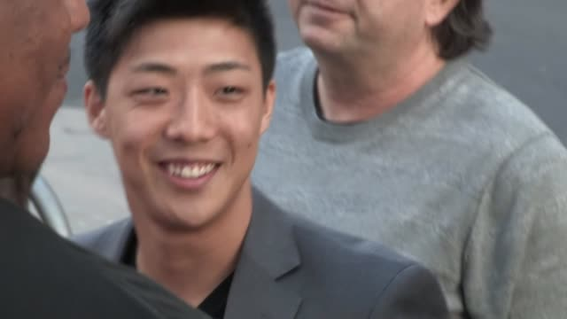 Justin Lee greets fans while arriving at the Arrested Development Season 4 Premiere in Hollywood 04/29/13