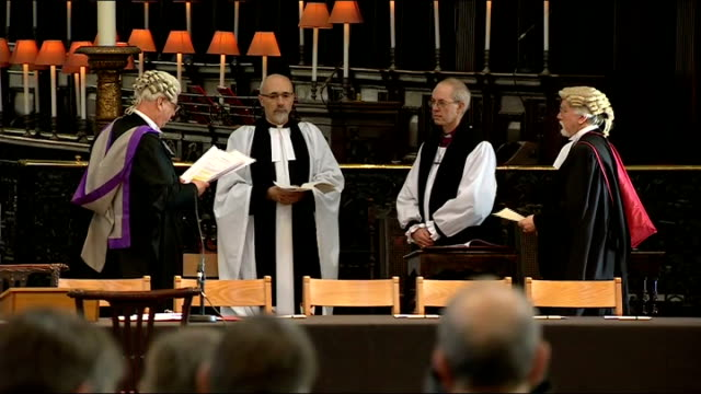 justin welby confirmed as 105th archbishop of canterbury england london st paul's cathedral int most rev justin welby standing with other clergymen... - カンタベリー大主教点の映像素材/bロール