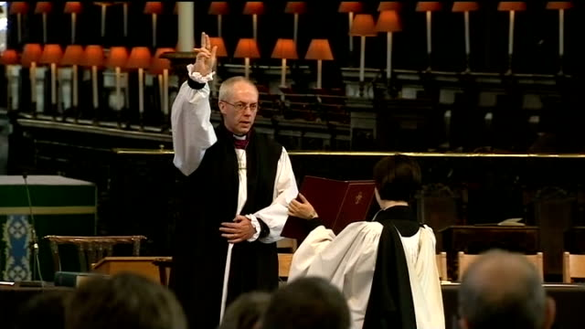 justin welby enthroned as archbishop of canterbury lib / tx st paul's cathedral welby carrying out blessing at his confirmation service sot the lord... - wife carrying stock videos and b-roll footage