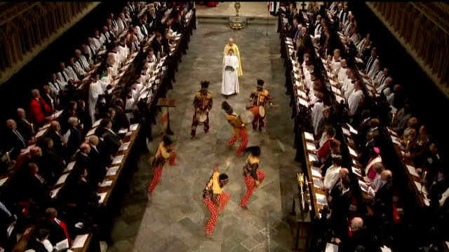justin welby enthroned as archbishop of canterbury **music heard sot** african dancers performing in cathedral during enthronement service welby... - カンタベリー大主教点の映像素材/bロール