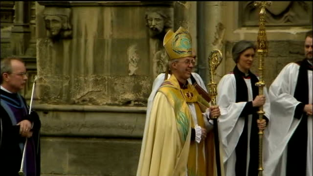 justin welby enthroned as archbishop of canterbury newly enthroned archbishop of canterbury justin welby along from cathedral with pastoral staff - throne stock videos & royalty-free footage