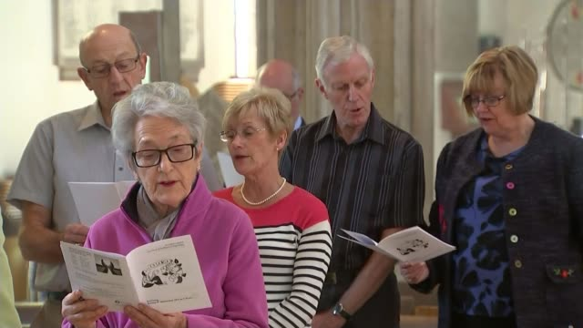 justin welby praises queen in run up to her becoming the longest reigning british monarch england int clergyman speaking at lectern choir singing and... - congregation stock videos & royalty-free footage