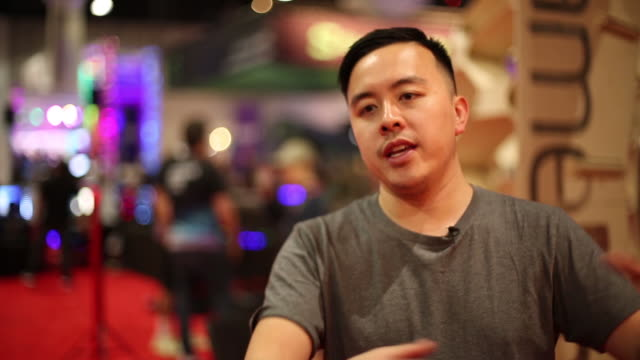 justin wu cmo & co-founder of rebl and head of growth at coinstate talks about the coinstate community at e3 2019 event in los angeles, california on... - impatto video stock e b–roll