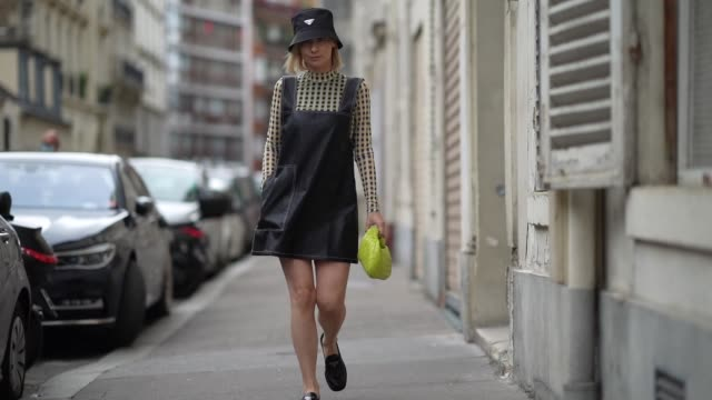 justyna czerniak wears a black prada bob hat, a black dress, a yellow and black checkered top, a yellow woven leather bag from bottega veneta, black... - black dress stock videos & royalty-free footage