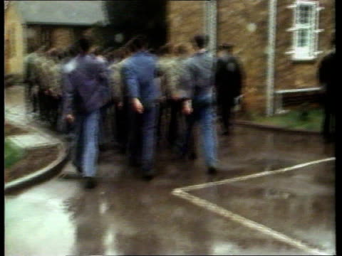vídeos de stock, filmes e b-roll de government proposes secure training centres tx 23381 1970's surrey send detention centre ext bv formation of young offenders marching away in short... - send