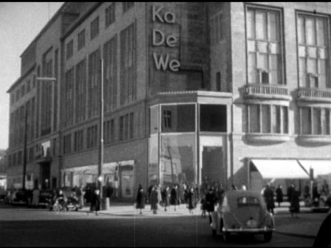 ka de we' department store in west berlin, various shoppers window shopping, looking at glass displays. - 1950 stock-videos und b-roll-filmmaterial