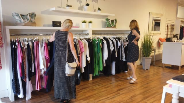 stockvideo's en b-roll-footage met kaarina wardell helps barbara white look at dresses as she shops at the must boutique store as the state of florida enters phase one of the plan to... - kledingstuk