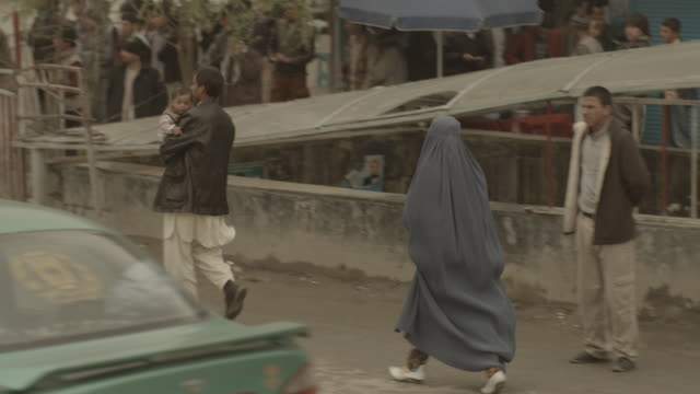 kabul city streets, blue burqa and white boots - burka stock videos and b-roll footage