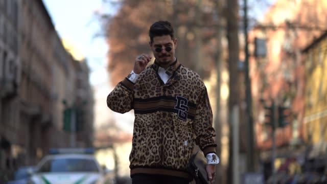 Kadu Dantas wears sunglasses and a leopard print jacket outside Dolce Gabbana during Milan Menswear Fashion week Fall/Winter 2018/19 on January 13...