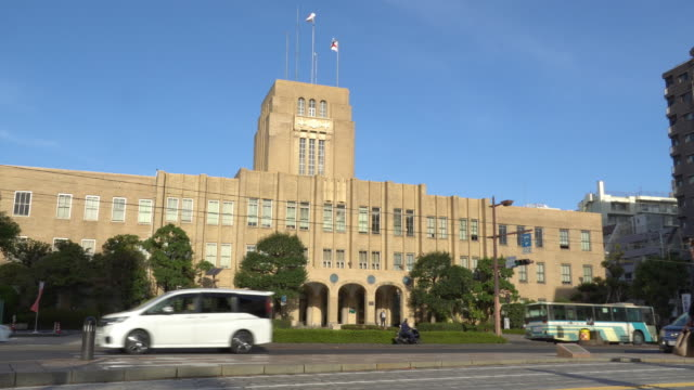 kagoshima city hall in downtown center, japan - editorial stock videos & royalty-free footage
