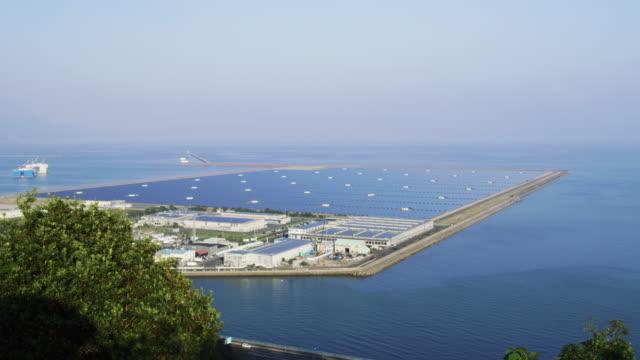 ms kagoshima nanatsujima solar power plant / kagoshima, japan - 発電所点の映像素材/bロール