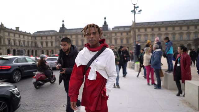 kailand morris wears a red and white sweater red pants with cargo pockets white sneakers outside offwhite during paris fashion week menswear f/w... - paris fashion week stock videos & royalty-free footage