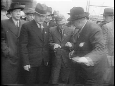 kaiser shipyards / yyacheslav molotov and henry kaiser / workers wave / pan of vast shipyard / crowd walks dock / molotov visits workers - henry j. kaiser stock videos and b-roll footage