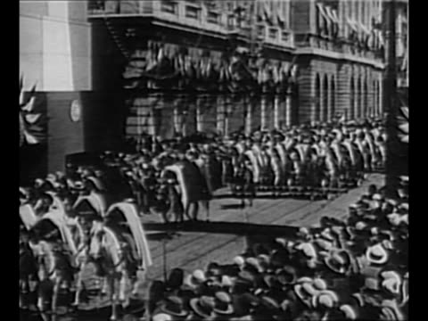 kaiser wilhelm ii conducts troop review / mounted soldiers on parade in german street as they approach camera, passing buildings decorated with flags... - cavalry stock videos & royalty-free footage