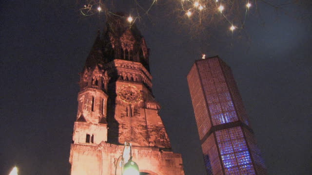 ms, tu, la, kaiser wilhelm memorial church illuminated at night, kurfuerstendamm, berlin, germany - christmas tree stock videos & royalty-free footage