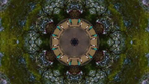 kaleidoscope effect of people walking in angkor with little planet effect - kaleidoscope pattern stock videos & royalty-free footage