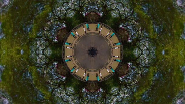 kaleidoscope effect of people walking in angkor with little planet effect - kaleidoskop muster stock-videos und b-roll-filmmaterial