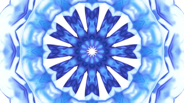 stockvideo's en b-roll-footage met kaleidoscope patten created with blue purple metallic silky fabric flowing and waving in super slow motion and close up, white background - caleidoscoop patroon