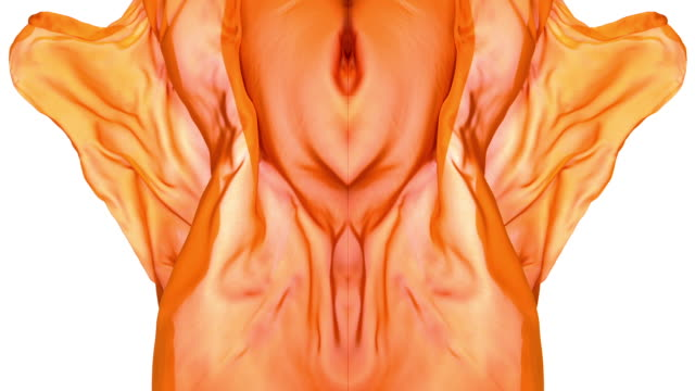 stockvideo's en b-roll-footage met kaleidoscope patten created with orange metallic silky fabric flowing and waving in super slow motion and close up, white background - caleidoscoop patroon
