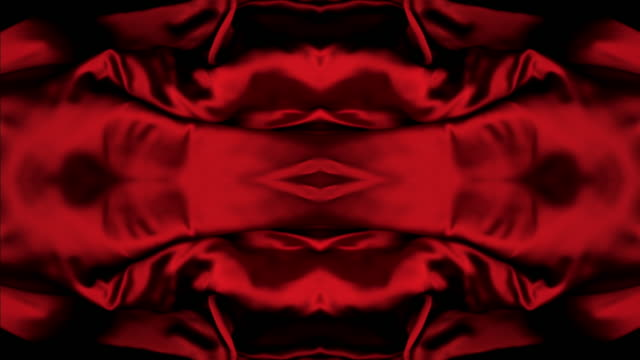 vidéos et rushes de kaleidoscope patten created with red silky fabric flowing and waving in super slow motion and close up, black background - style artistique