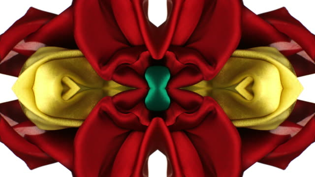 kaleidoscope patten created with red, yellow and green silky fabrics flowing and waving in super slow motion and close up, white background - super slow motion stock videos & royalty-free footage