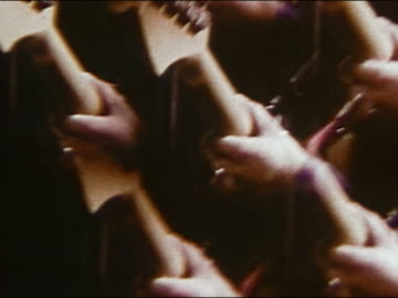 1968 kaleidoscopic images of man playing guitar and young people dancing swirling around - 10 sekunden oder länger stock-videos und b-roll-filmmaterial