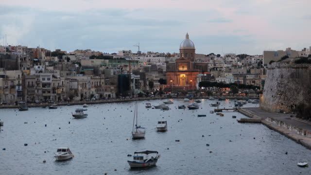 t/l ws kalkara cityscape day to night transition / valletta, malta - valletta stock videos & royalty-free footage
