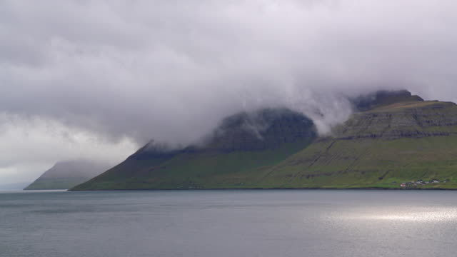 kalsoy island fjord faroe islands moving clouds 4k - north atlantic ocean stock videos & royalty-free footage
