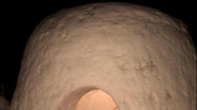a kamakua snow hut glows at night. - igloo stock videos & royalty-free footage