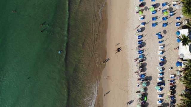 vídeos de stock, filmes e b-roll de kamala beach in phuket, thailand, southern of thailand - chapéu de sol