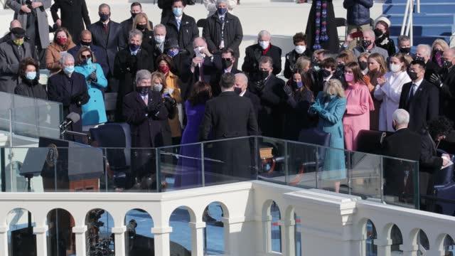 kamala harris is sworn in as u.s. vice president as her husband doug emhoff looks on at the inauguration of u.s. president-elect joe biden on the... - 副代表点の映像素材/bロール