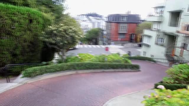 kamala harris profile; usa: california: san francisco: ext cars along lombard street, as people watch car along lombard street tracking winding down... - lombard street san francisco stock videos & royalty-free footage
